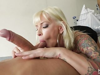 Brooke Banner in the garage sucking on a big young dick