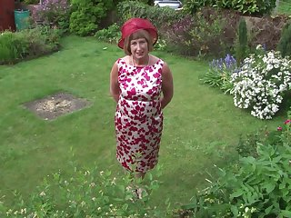 Mature granny Rosemary strips outdoors and plays with a dildo