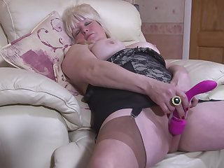 Mature busty blonde BBW Cindy S. plays with a dildo in her pussy