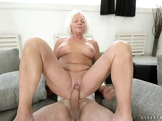 Dirty granny sits her shaved old pussy down on his dick