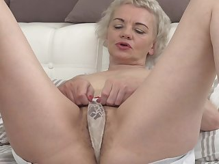 Kinky granny Rina M disjointedly moaning while she fingers her pussy