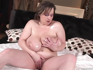 BBW Traci D. shows off her big boobs and plays with her pussy