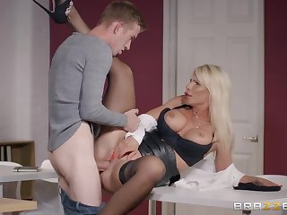Milf in a leather mini skirt needs go wool-gathering huge cock inside her