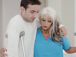 GILF physiotherapist Sally Dangelo gives a young sponger a sexual prescription